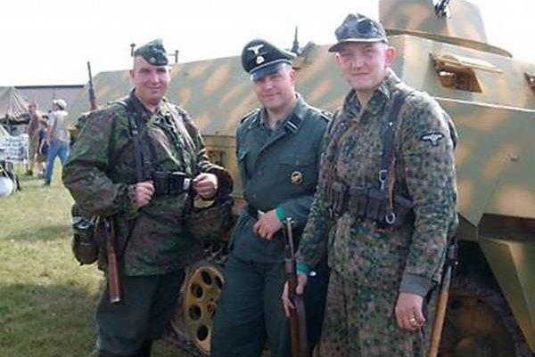 This photo alleges to show Philadelphia police Officer Ian Hans Lichterman, left, posing with fellow Nazi reenactors.